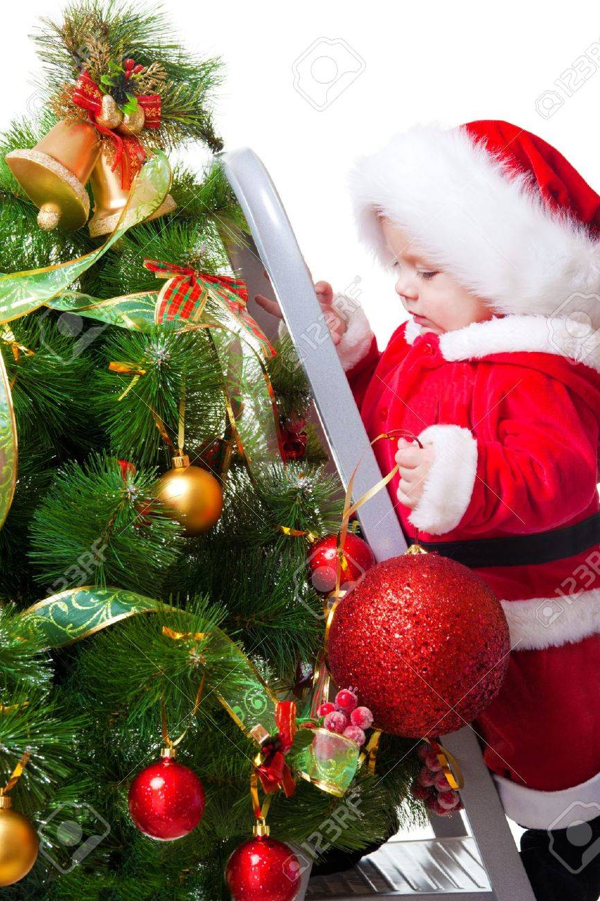 baby on the step ladder decorating christmas tree stock photo 8168614