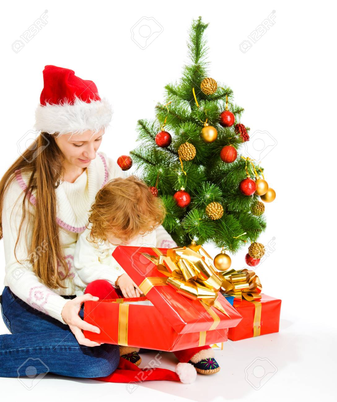 Mother and little daughter opening a present box Stock Photo - 8168631