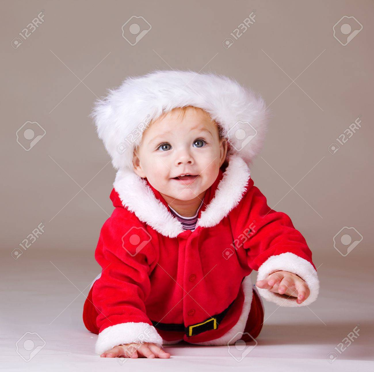 Crawling Christmas baby, over grey Stock Photo - 8372925