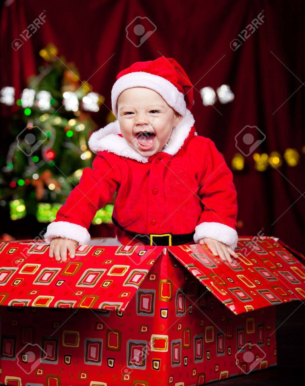 Adorable laughing kid in a large present box Stock Photo - 8372924