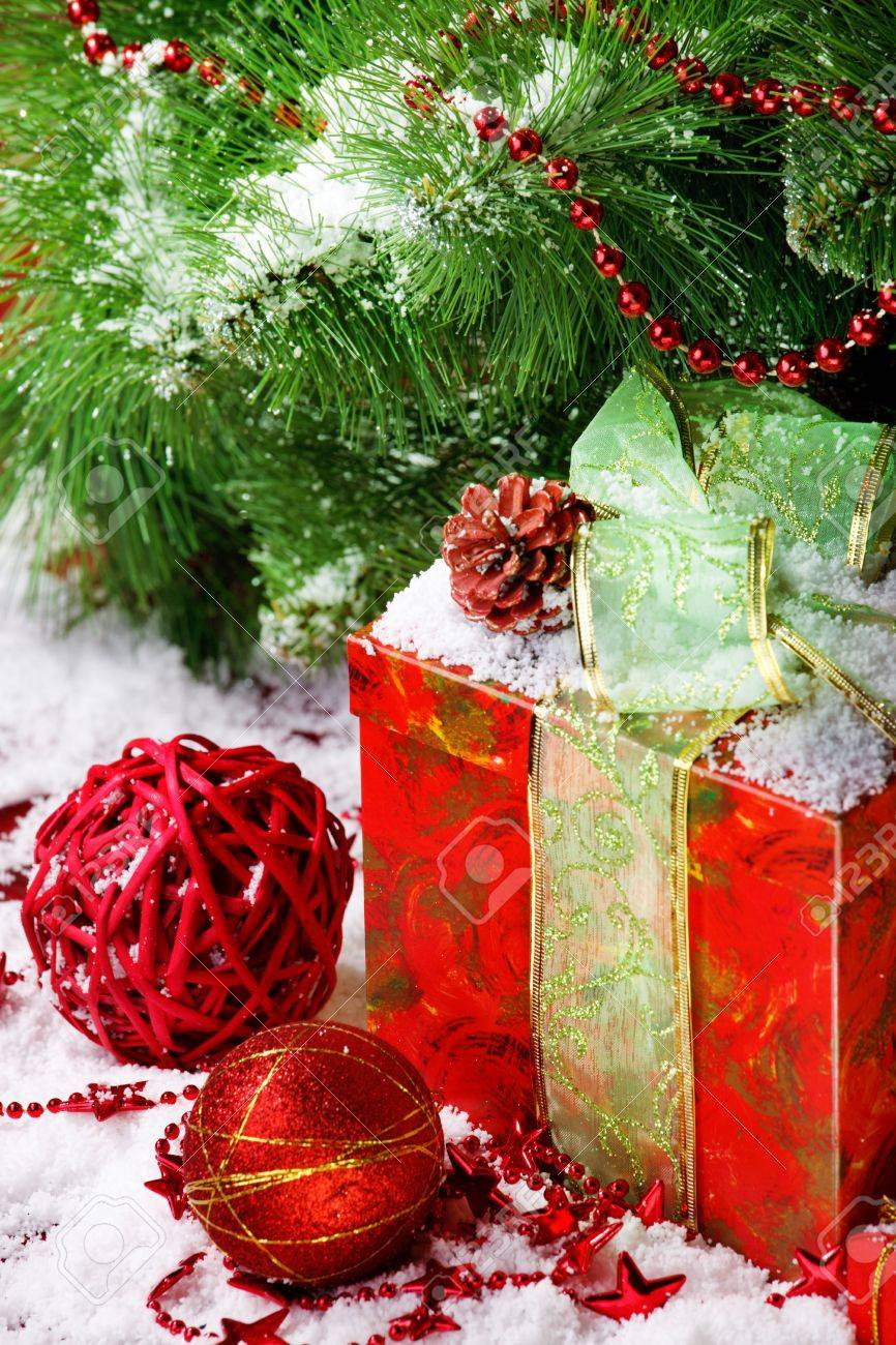 Red gift box under Christmas tree Stock Photo - 8373238