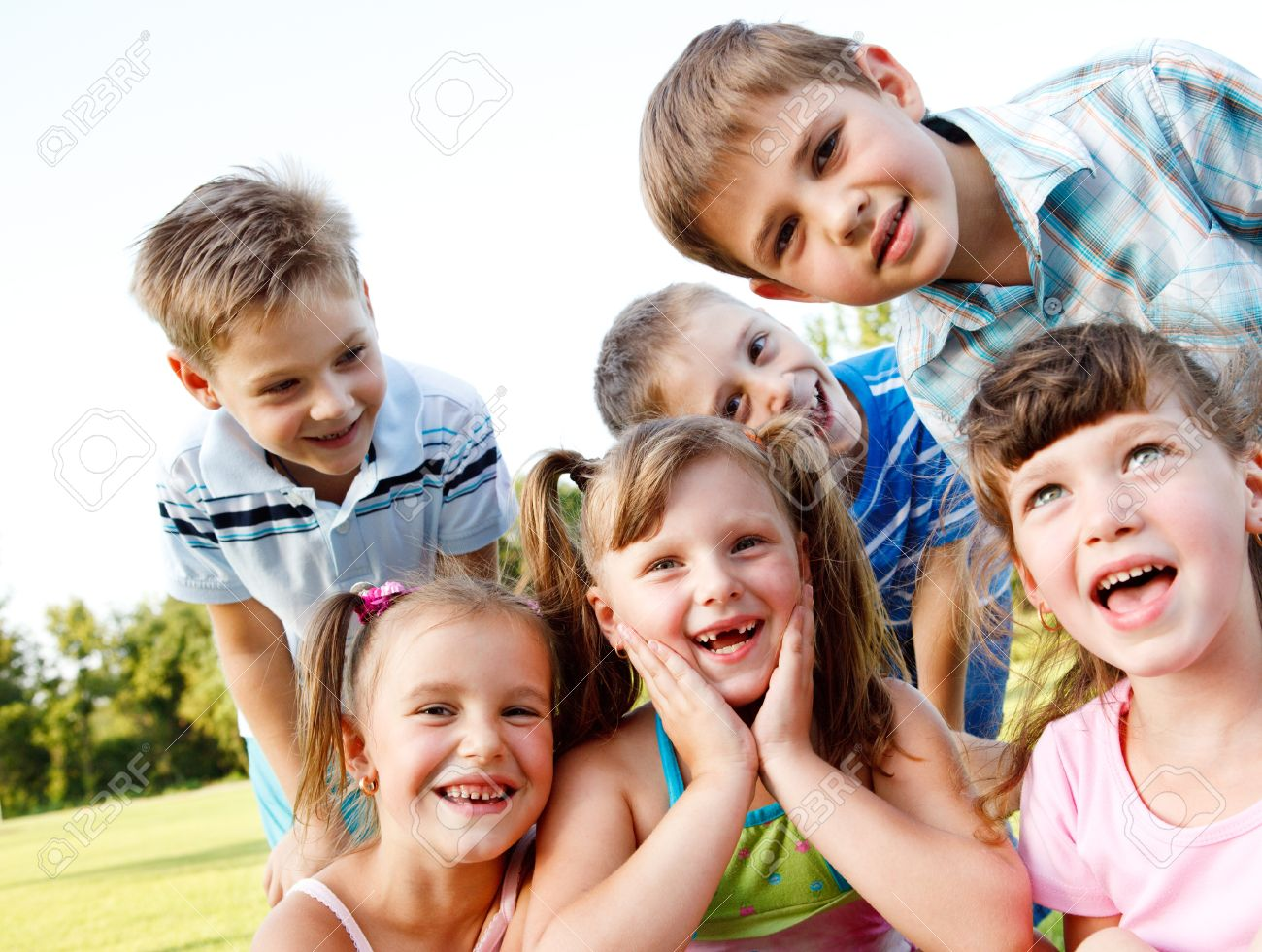 Six preschool friends looking in camera and laughing Stock Photo - 8590841