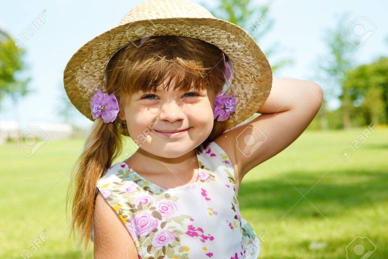 Attractive Caucasian girl in a straw hat Stock Photo - 8797269