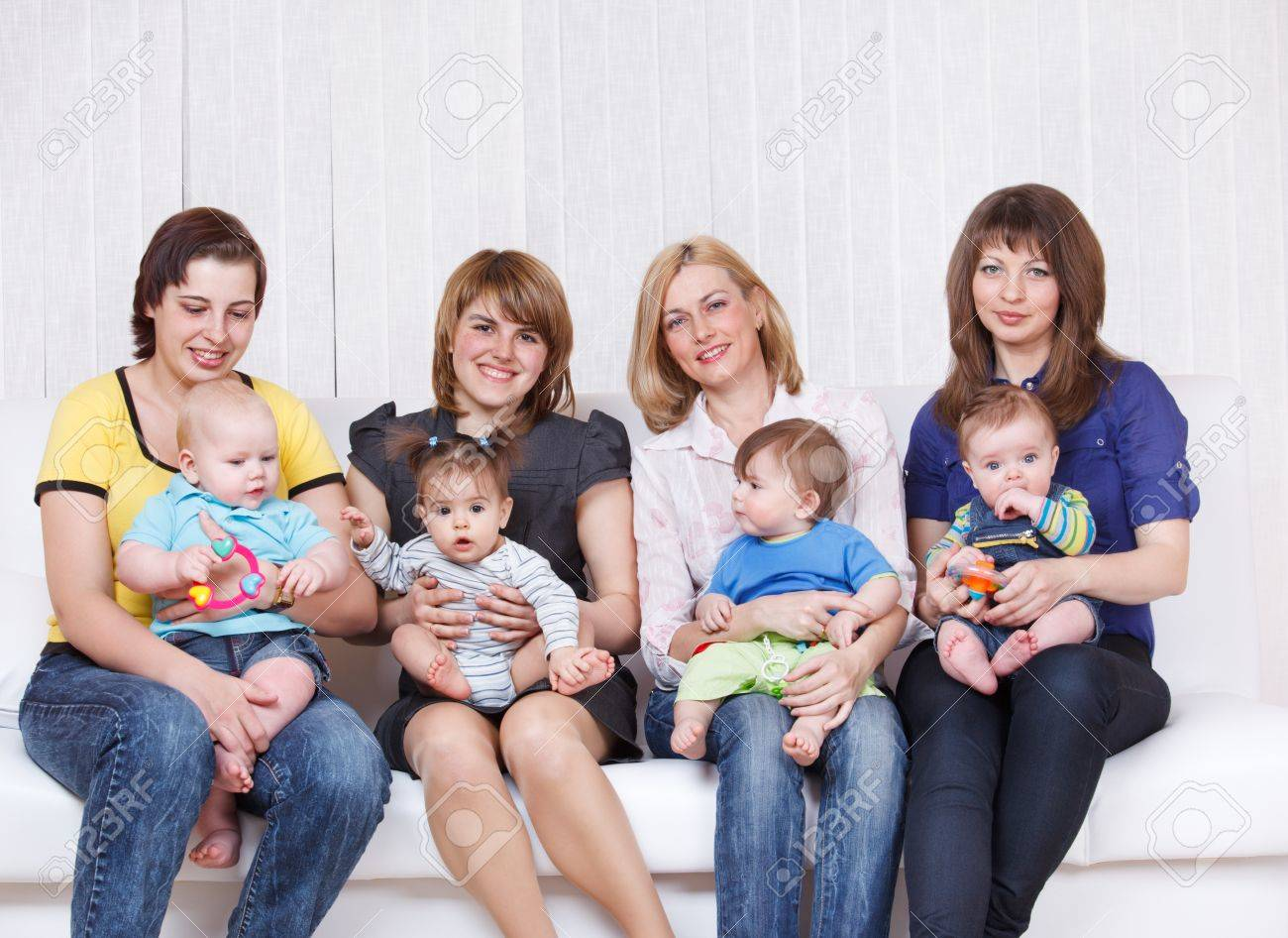 Four mothers with toddlers sitting on their knees Stock Photo - 9191508