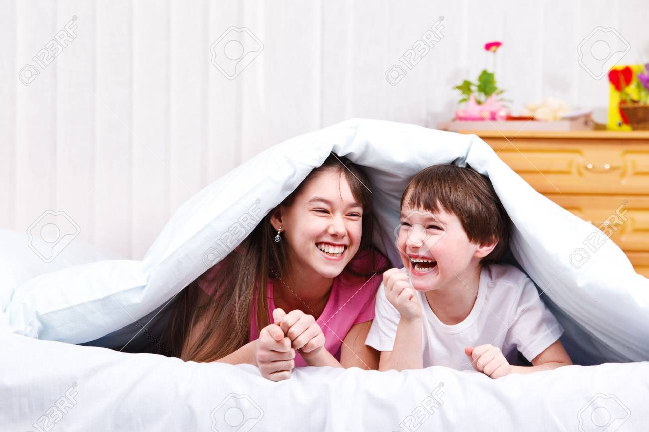 Children in bed, laughing Stock Photo - 9354777