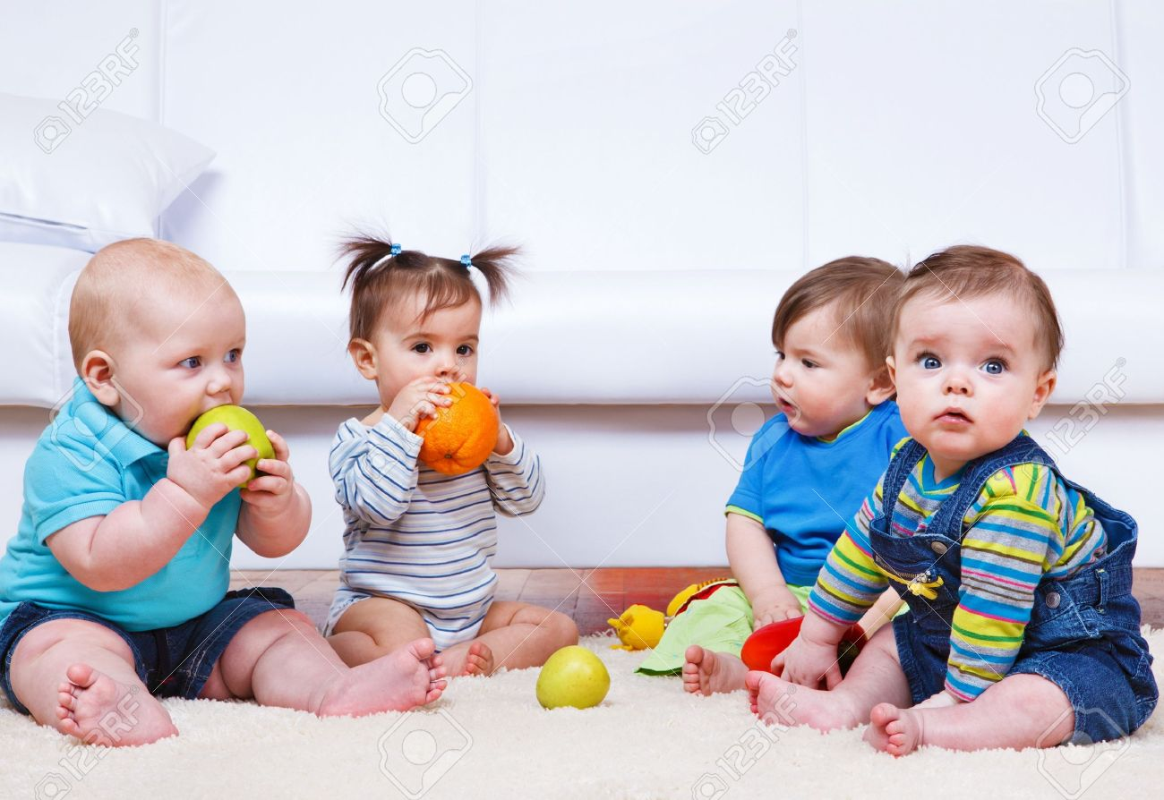 Four toddlers sitting in a lounge Stock Photo - 41260726