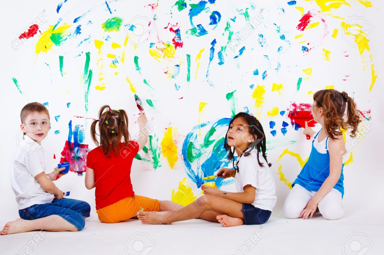 Four preschool kids painting the wall Stock Photo - 9587581