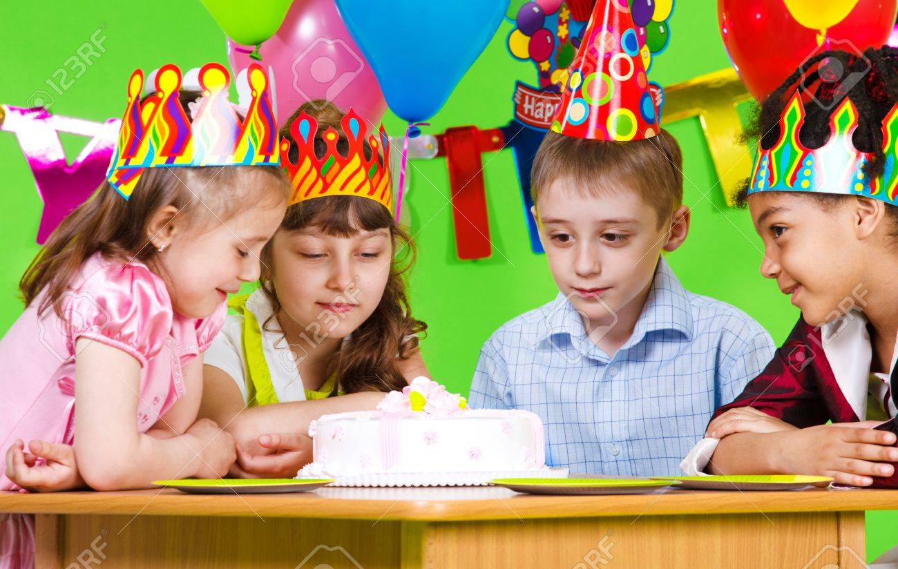 Hungry kids looking at birthday cake Stock Photo - 9587584