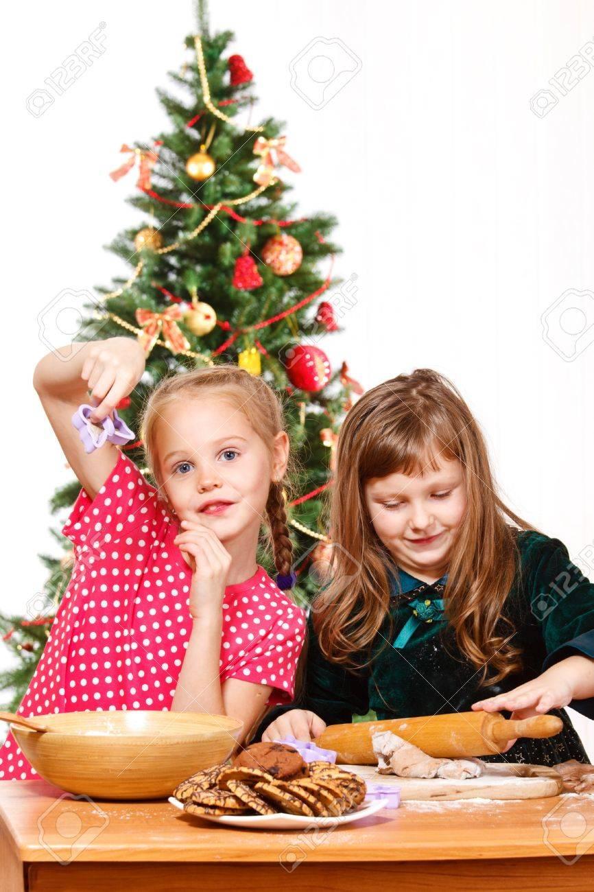 Two preschool girls making chocolate  cookies Stock Photo - 9617891