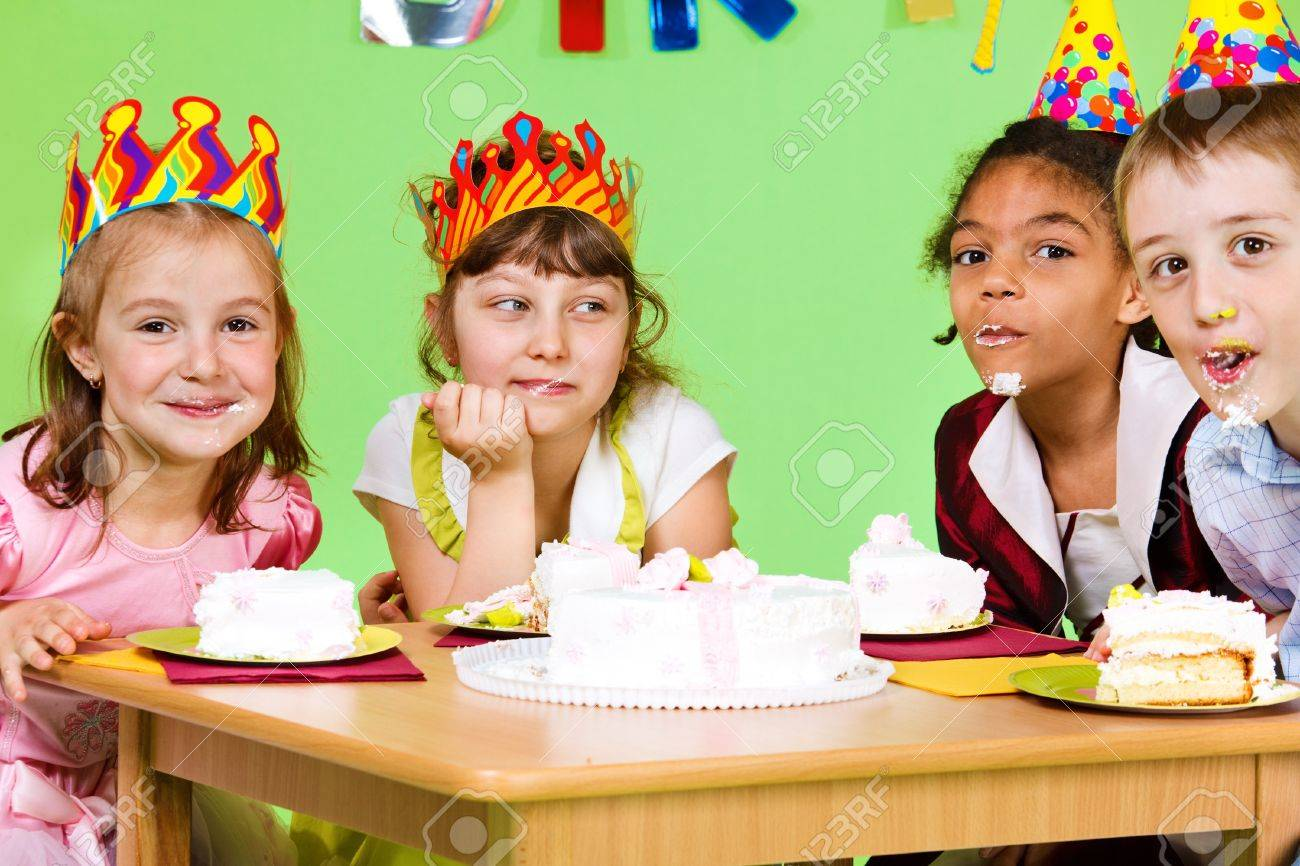 Cake Eating Contest At Birthday Party Stock Photo Picture And