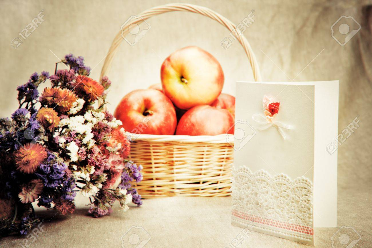 Apples in basket and wild flowers with blank greeting card Stock Photo - 9797666