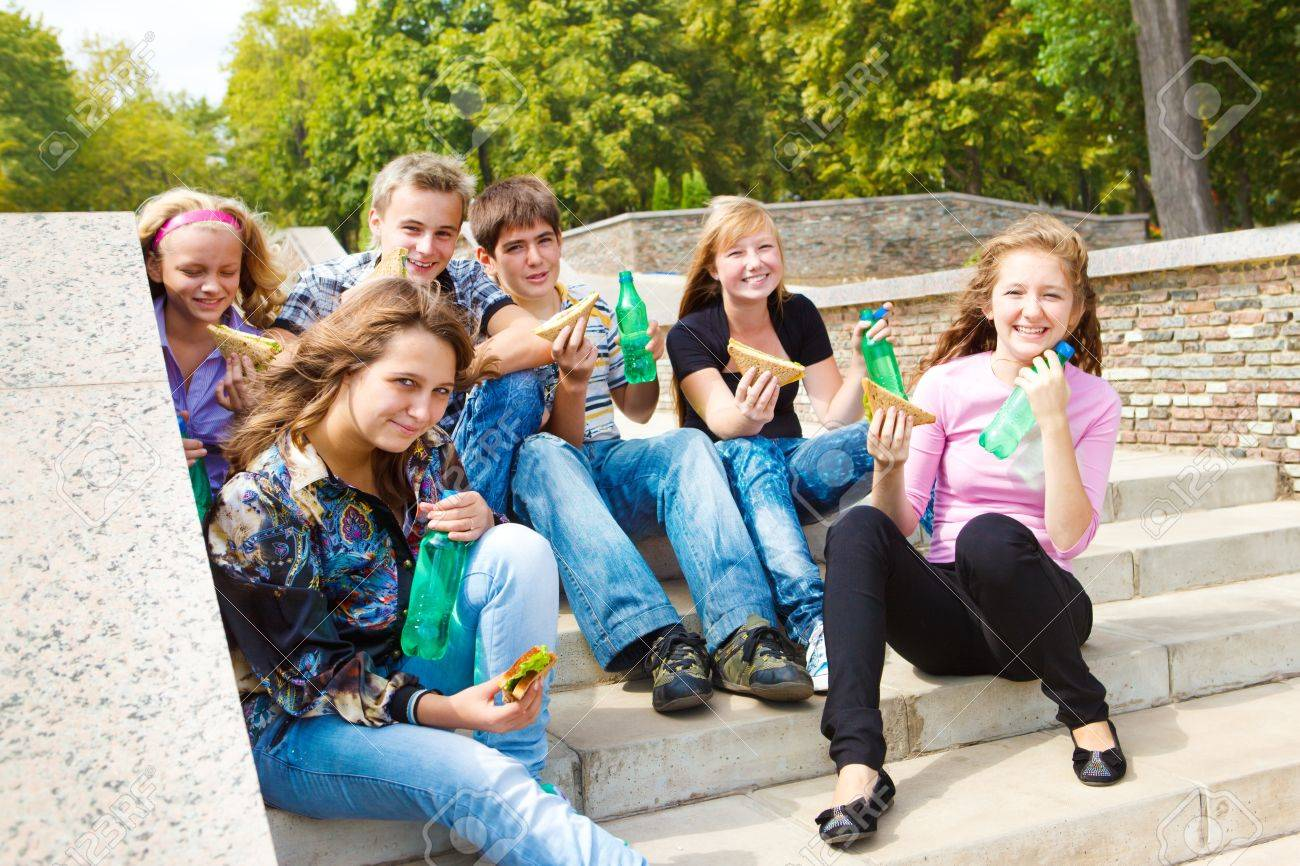 Hungry teenagers having snack time Stock Photo - 9978654