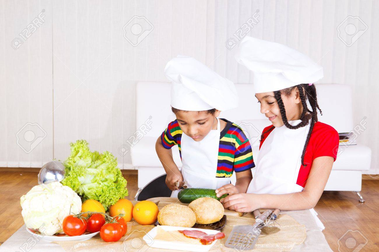 Boy and girl busy with cooking Stock Photo - 9978646