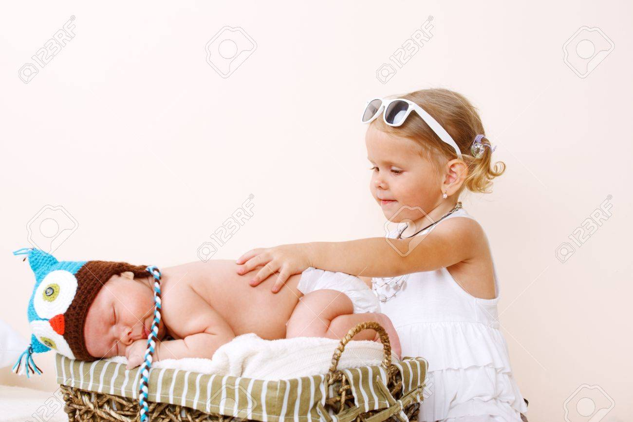 Sweet toddler girl and newborn baby sleeping Stock Photo - 10427967