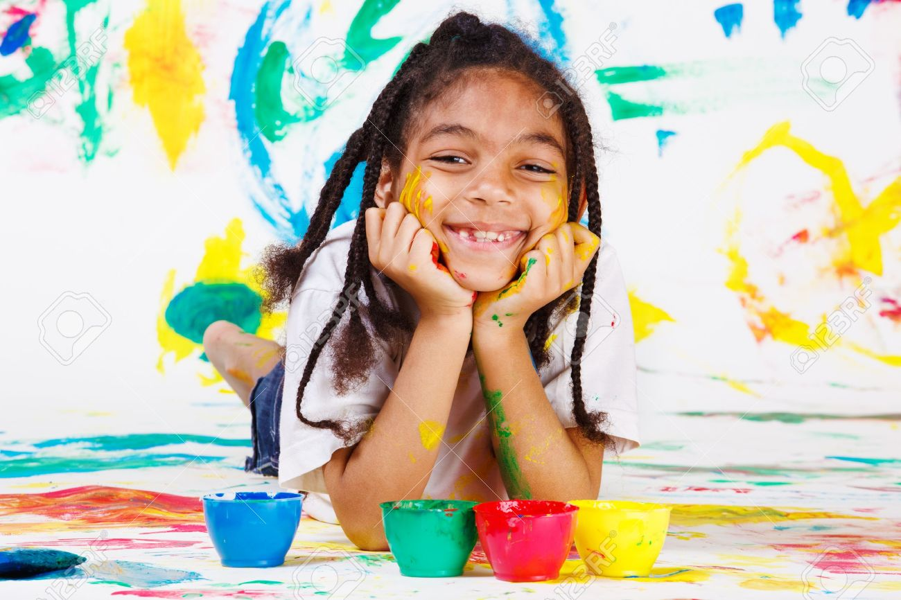 African American kid playing with finger paints Stock Photo - 10428012