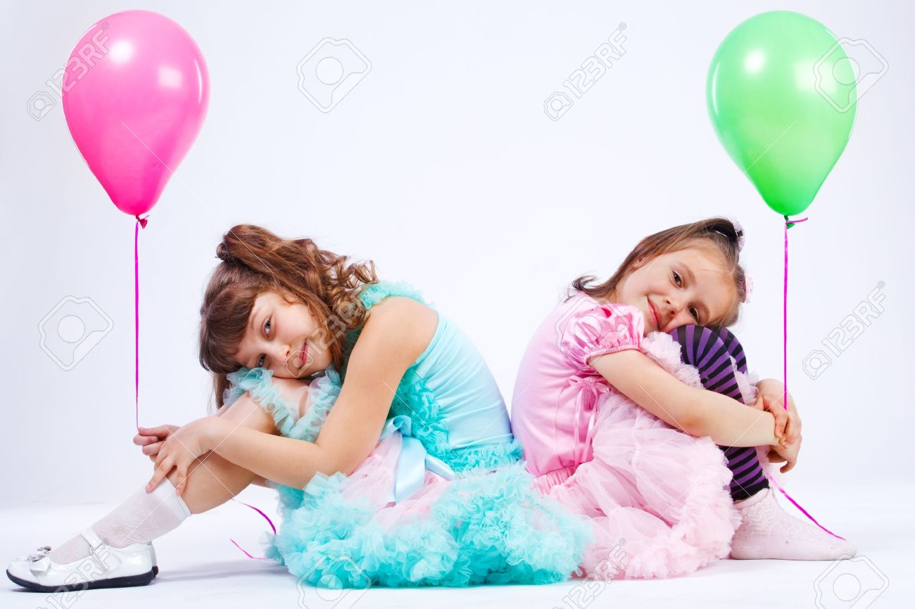 Two cute girls with balloons Stock Photo - 10427914