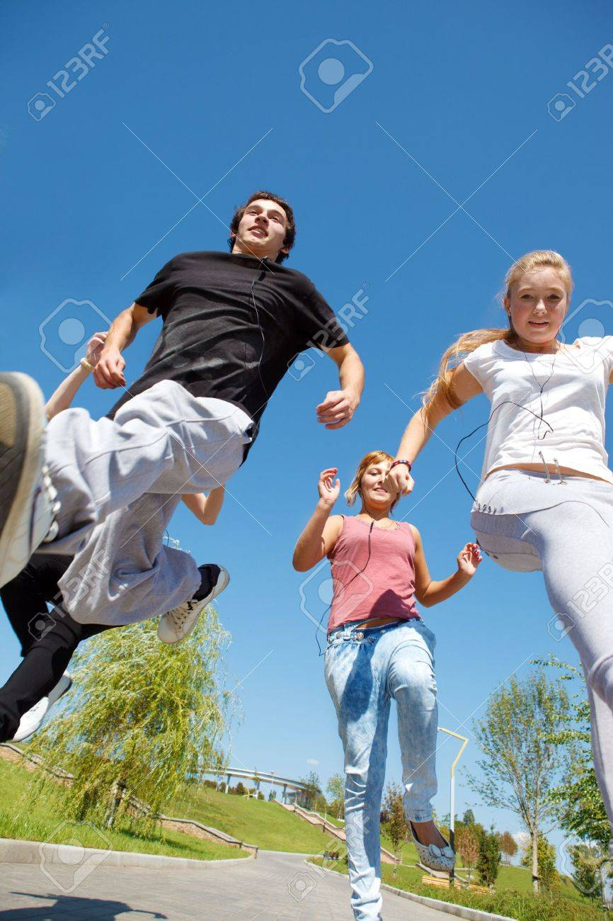Group of happy college students running Stock Photo - 10427987