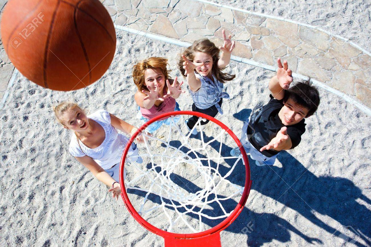Teenagers team playing street basketball - 10428026