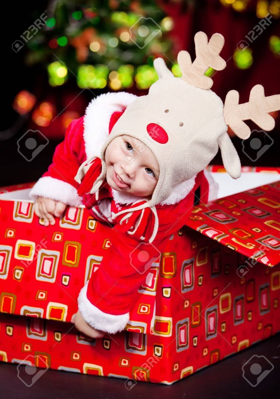 Baby boy sitting in a large present box Stock Photo - 10661648