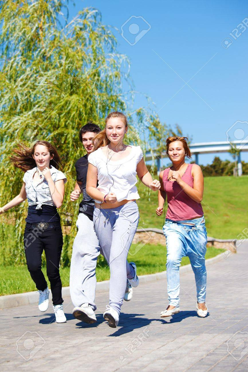 Teenage friends jogging in city park Stock Photo - 10744509