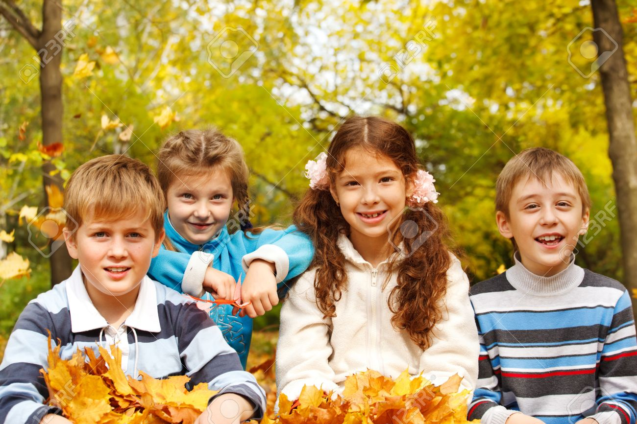 Portrait of four friendly kids in autumnal park Stock Photo - 10849327