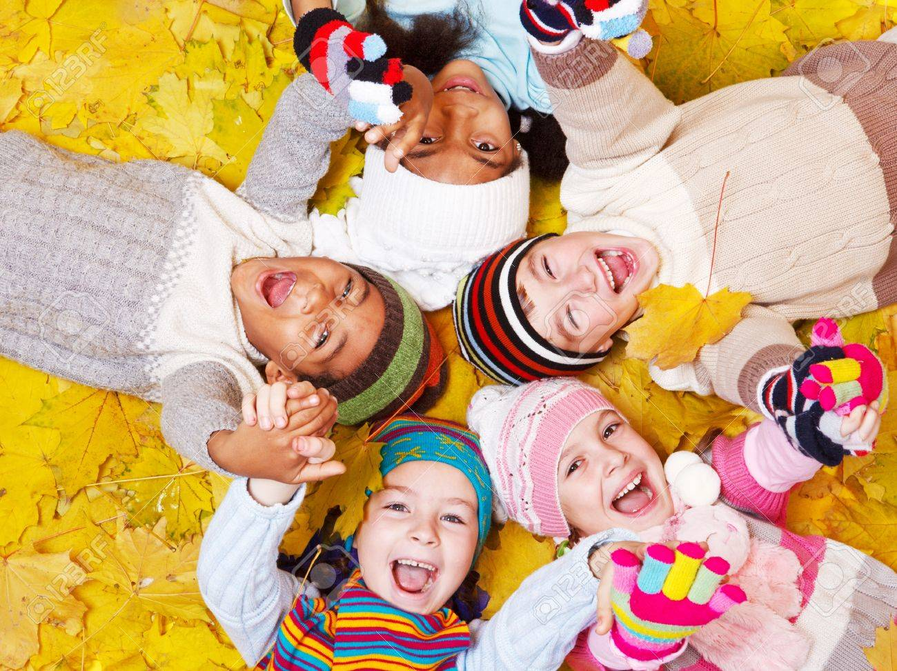 Laughing kids on autumnal leaves Stock Photo - 11134119