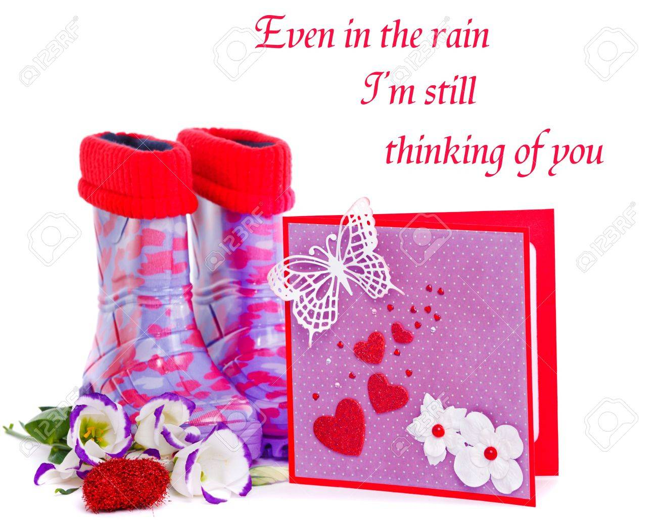 Rubber boots and a valentine greeting card Stock Photo - 12193323