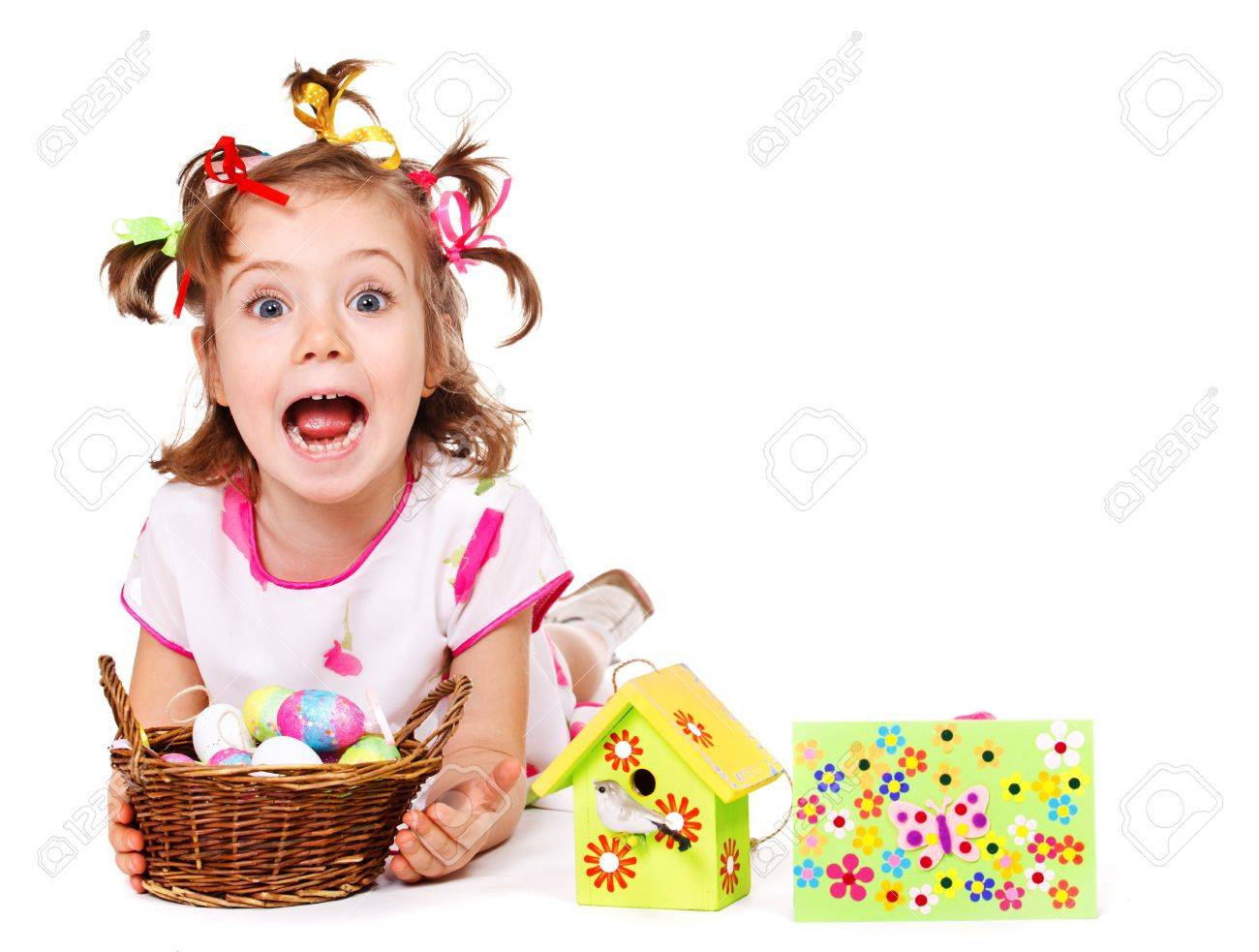 Funny little girl holding wicker basket with Easter eggs Stock Photo - 12193326