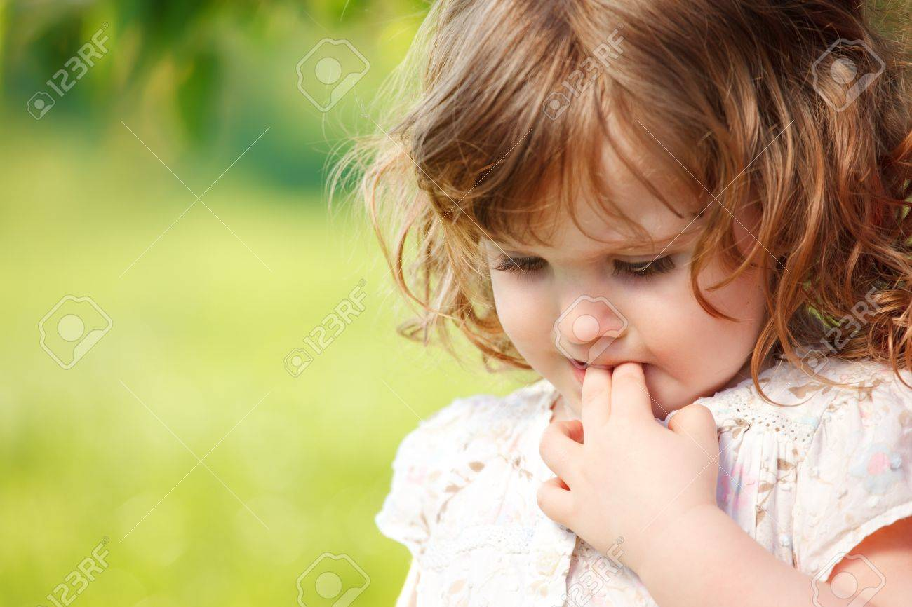 Portrait of a sad curly little girl Stock Photo - 13486393