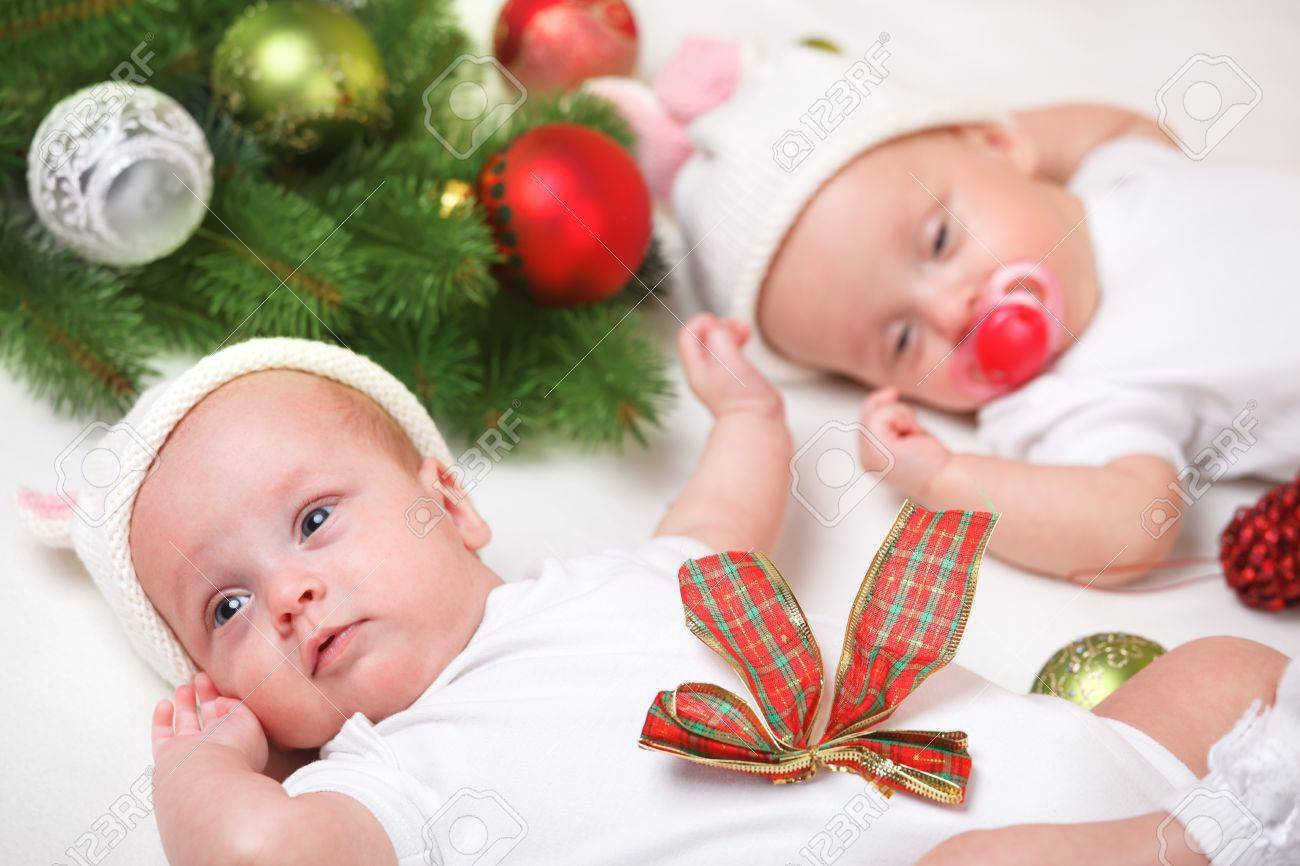 Christmas twin newborn babies in white stock photo picture and christmas twin newborn babies in white stock photo 15451194 voltagebd Choice Image