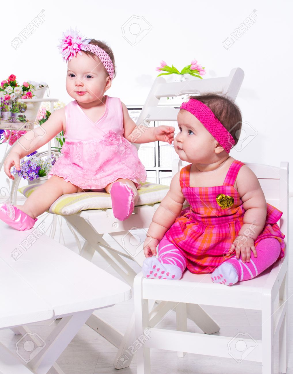 two cute baby friends sitting stock photo, picture and royalty free