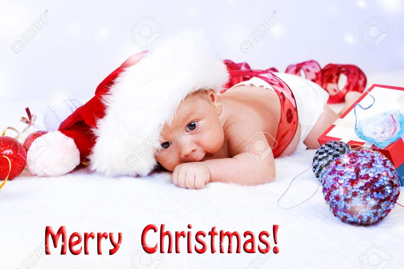 69f7e9142e2 Cute infant in Santa hat and Christmas decoration Stock Photo - 23560883