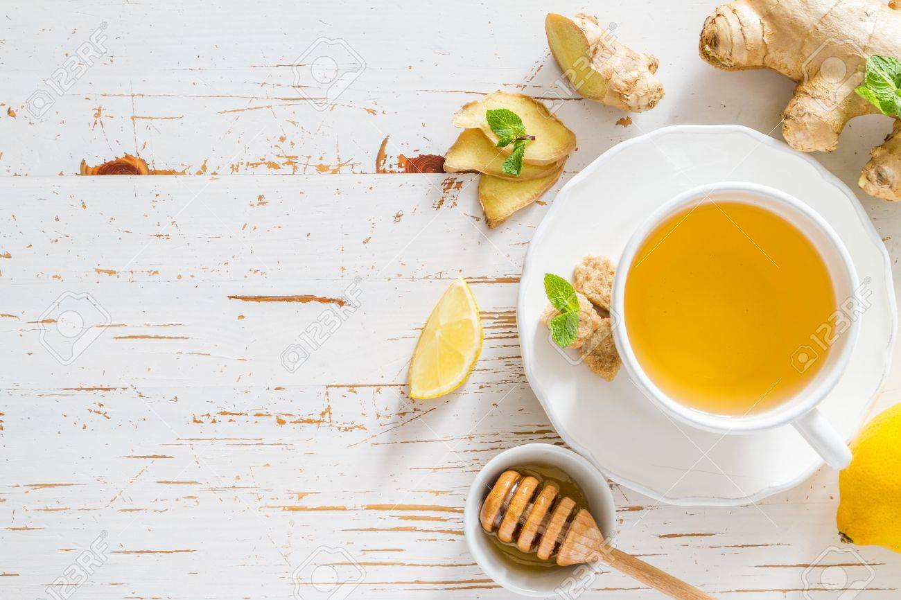 Ginger tea and ingredients on white wood background, copy space Stock Photo - 48432807