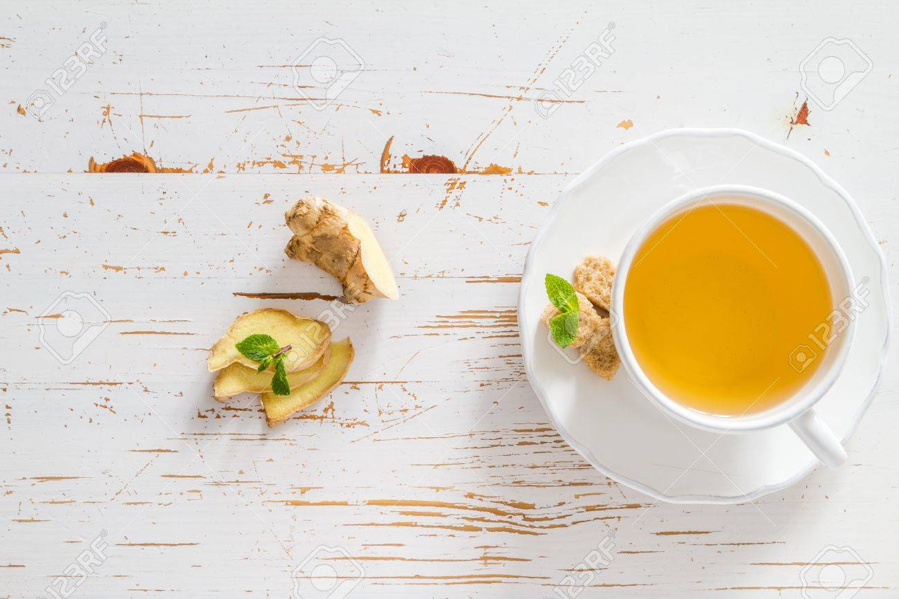 Ginger tea and ingredients on white wood background, copy space Stock Photo - 48432808