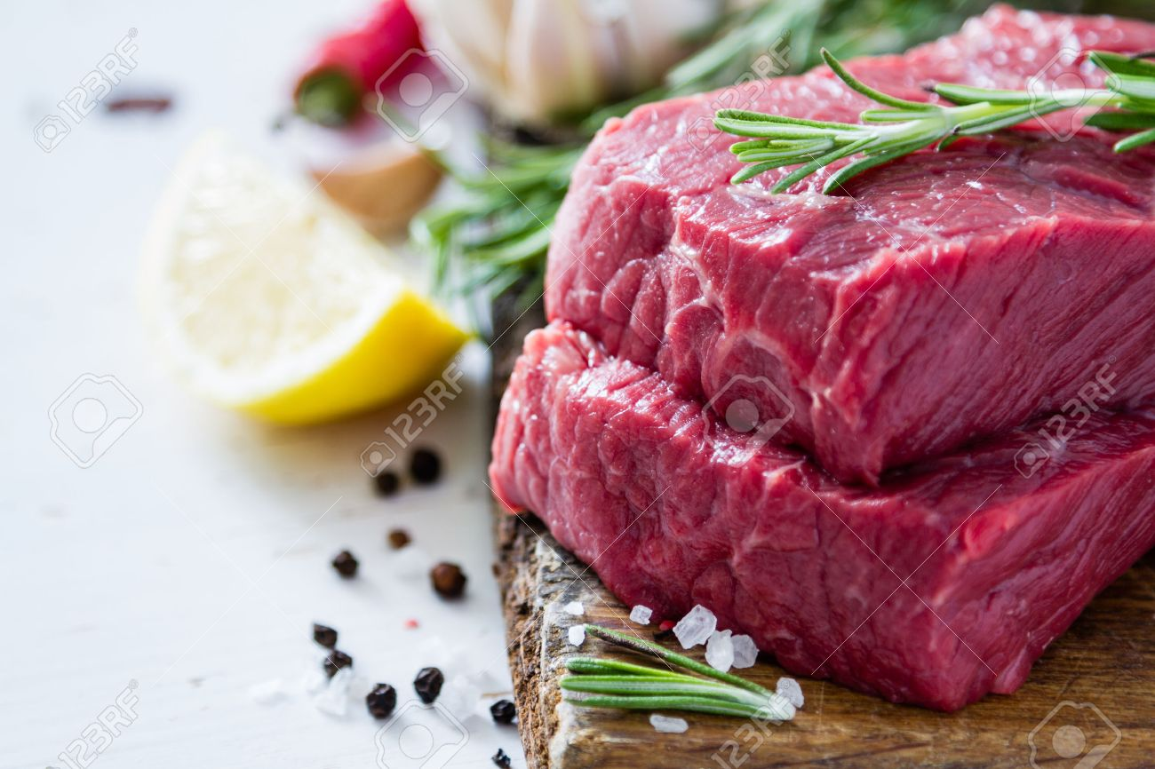 Raw sliced meat rosemary on wood background Stock Photo - 48434092