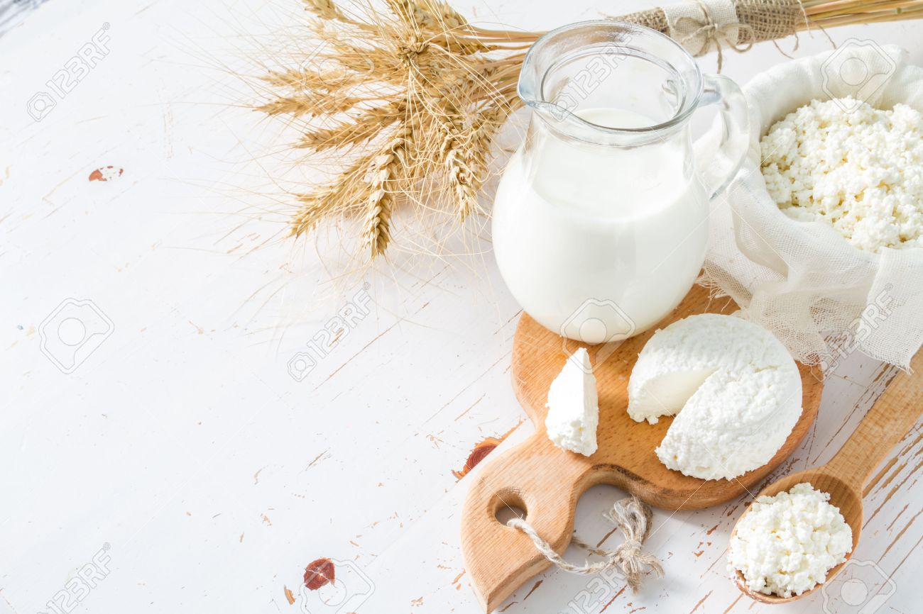 Selection of dairy products and wheat on white wood background Stock Photo - 48434159
