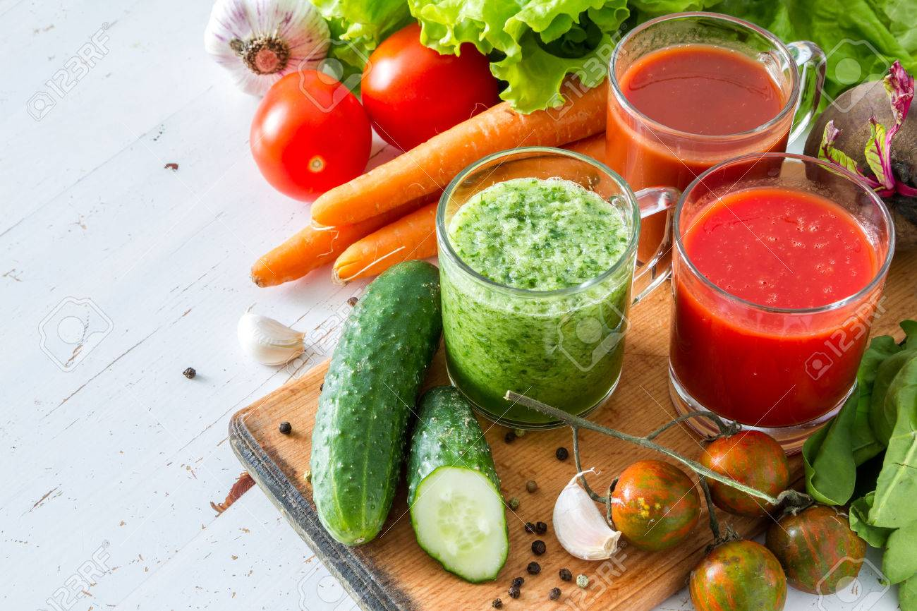 Selection of vegetables and juice, white wood background Stock Photo - 48434323