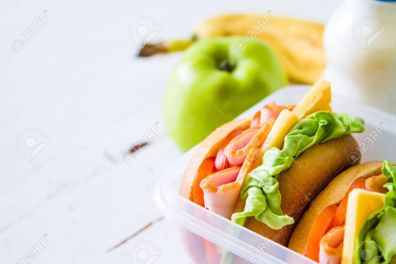 Lunch box with sandwich salad and friuts, white wood background Stock Photo - 48453710