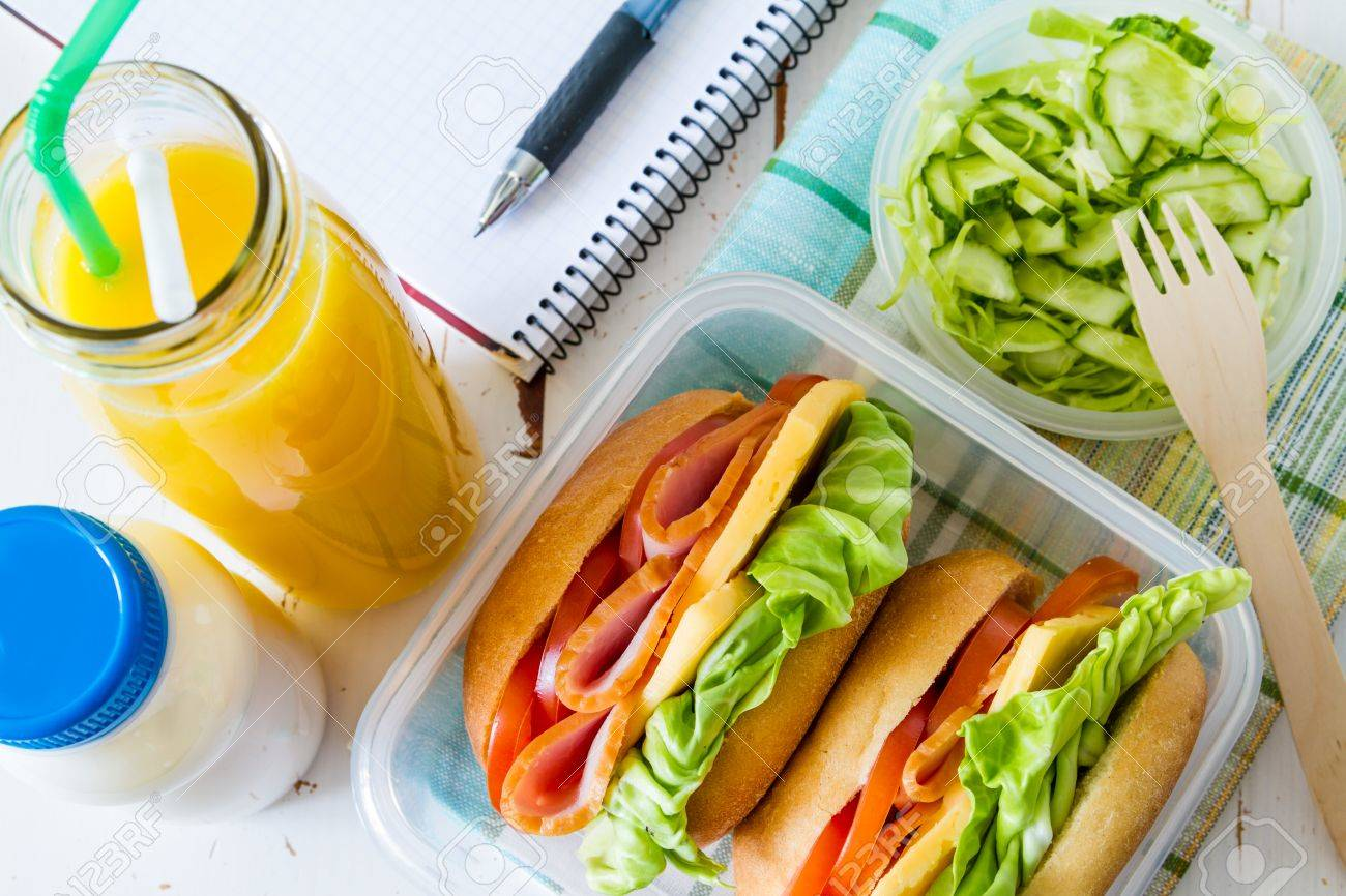 Lunch box with sandwich salad and friuts, white wood background, top view Stock Photo - 48453813