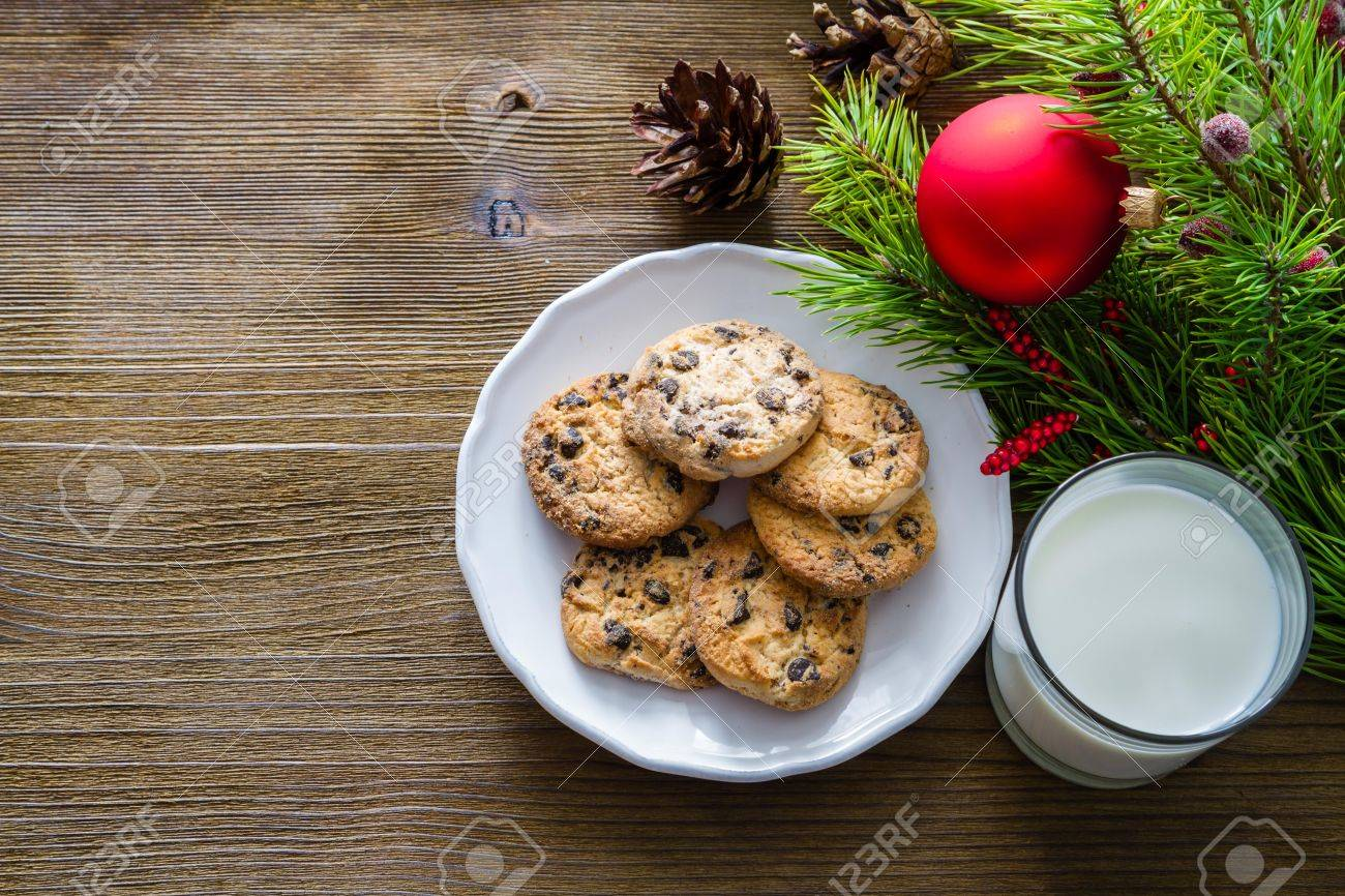 Cookies and milk for Santa Clause on wood background, copy space Stock Photo - 48503695