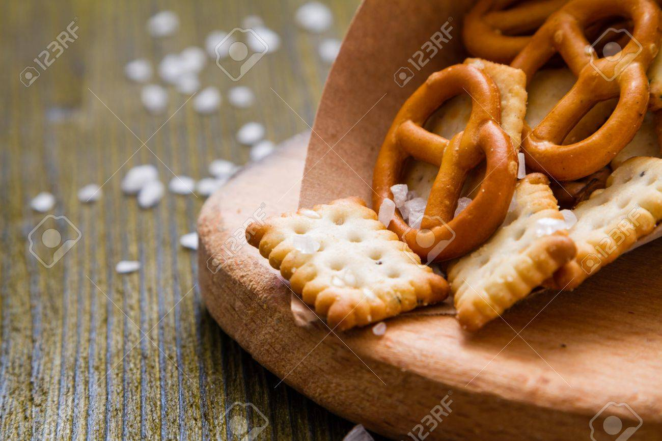 Selection of salty snacks, wood background, closeup Stock Photo - 48503583
