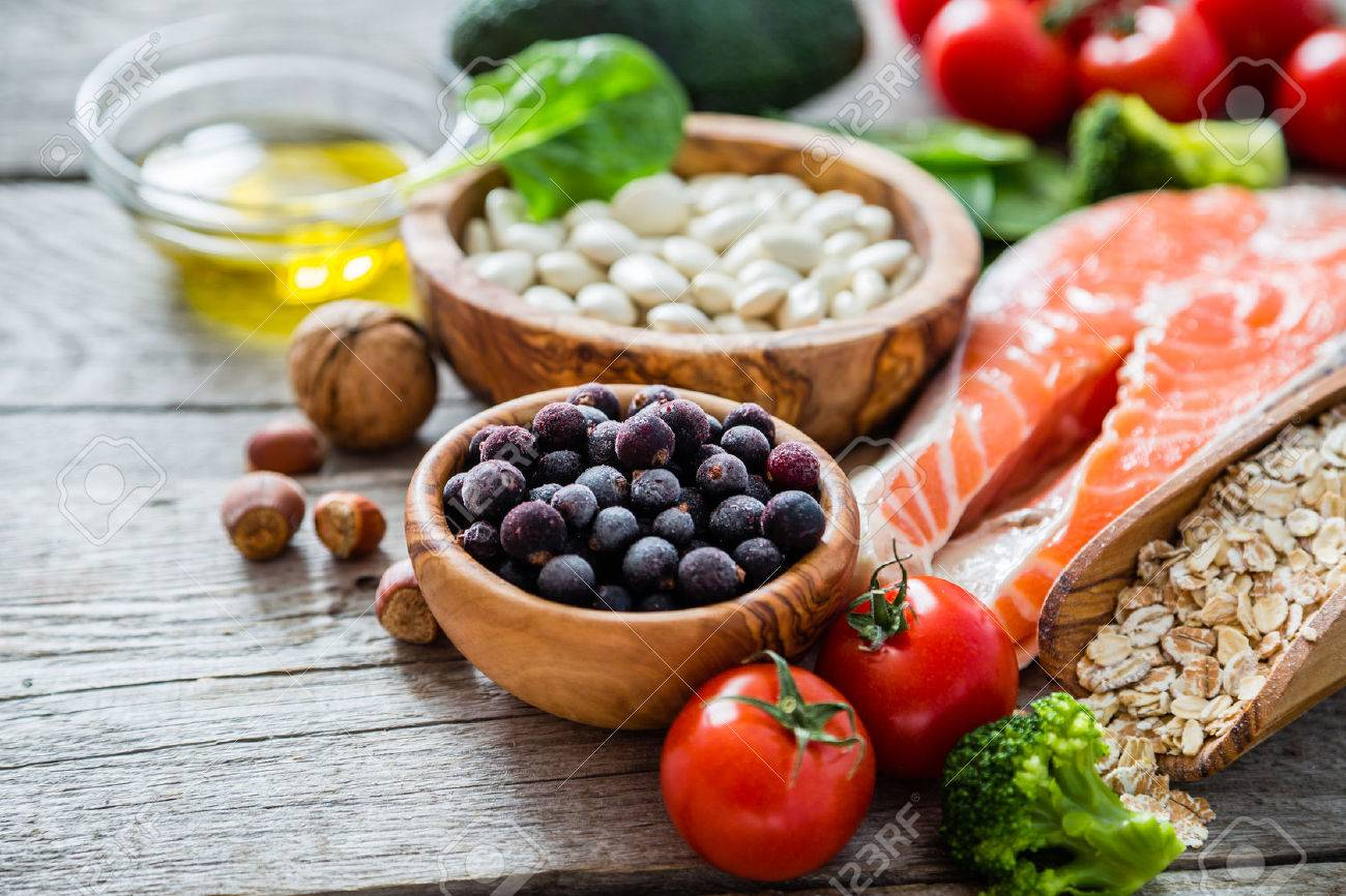 Selection of food that is good for the heart, rustic wood background Stock Photo - 54514925