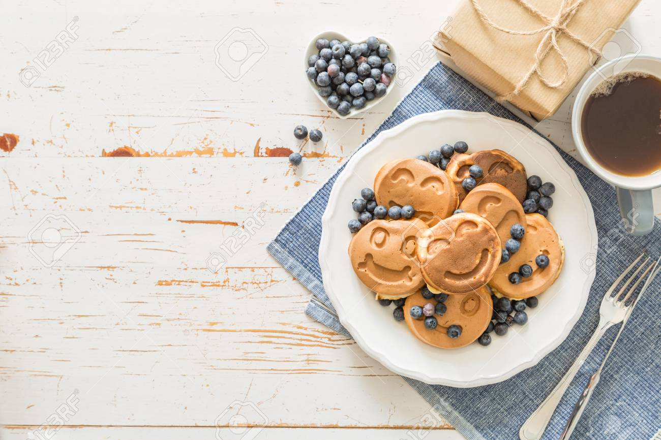 Fathers day concept - pancakes with blueberries and gift, copy space Stock Photo - 58155095