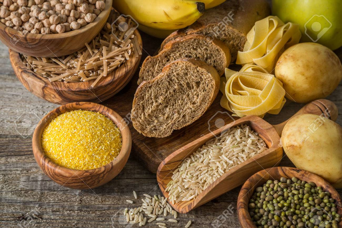Selection of comptex carbohydrates sources on wood background, copy space - 58154917