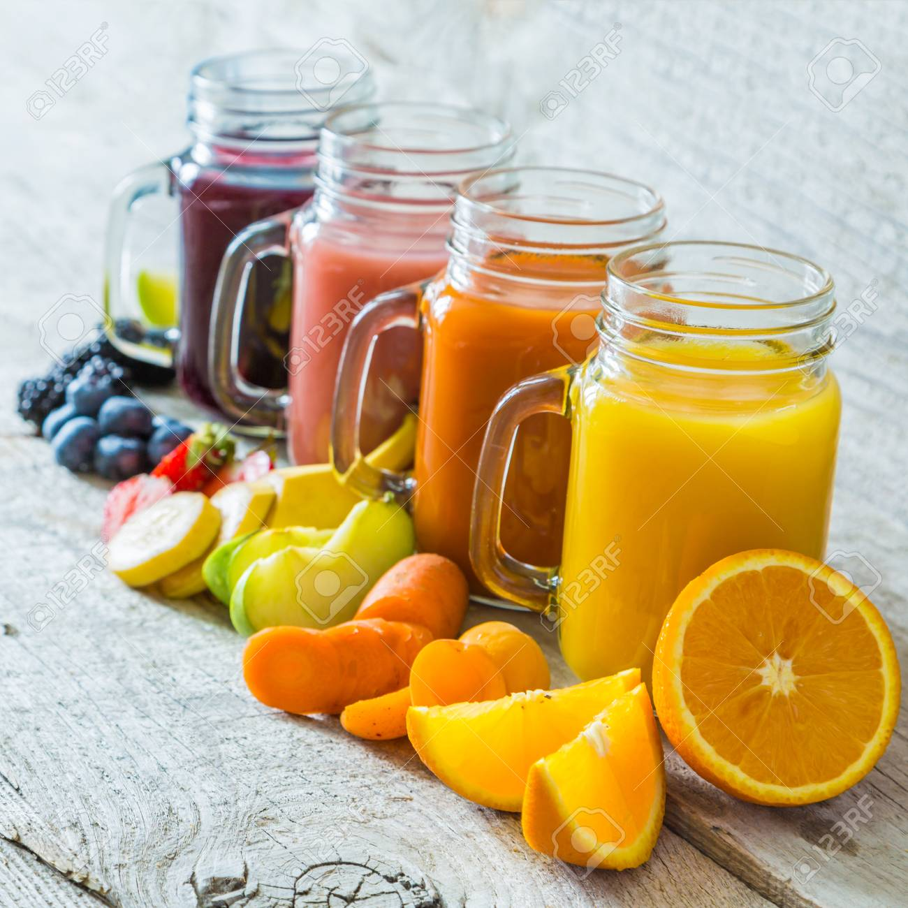 slection of fresh fruit juices in jars copy space stock photo
