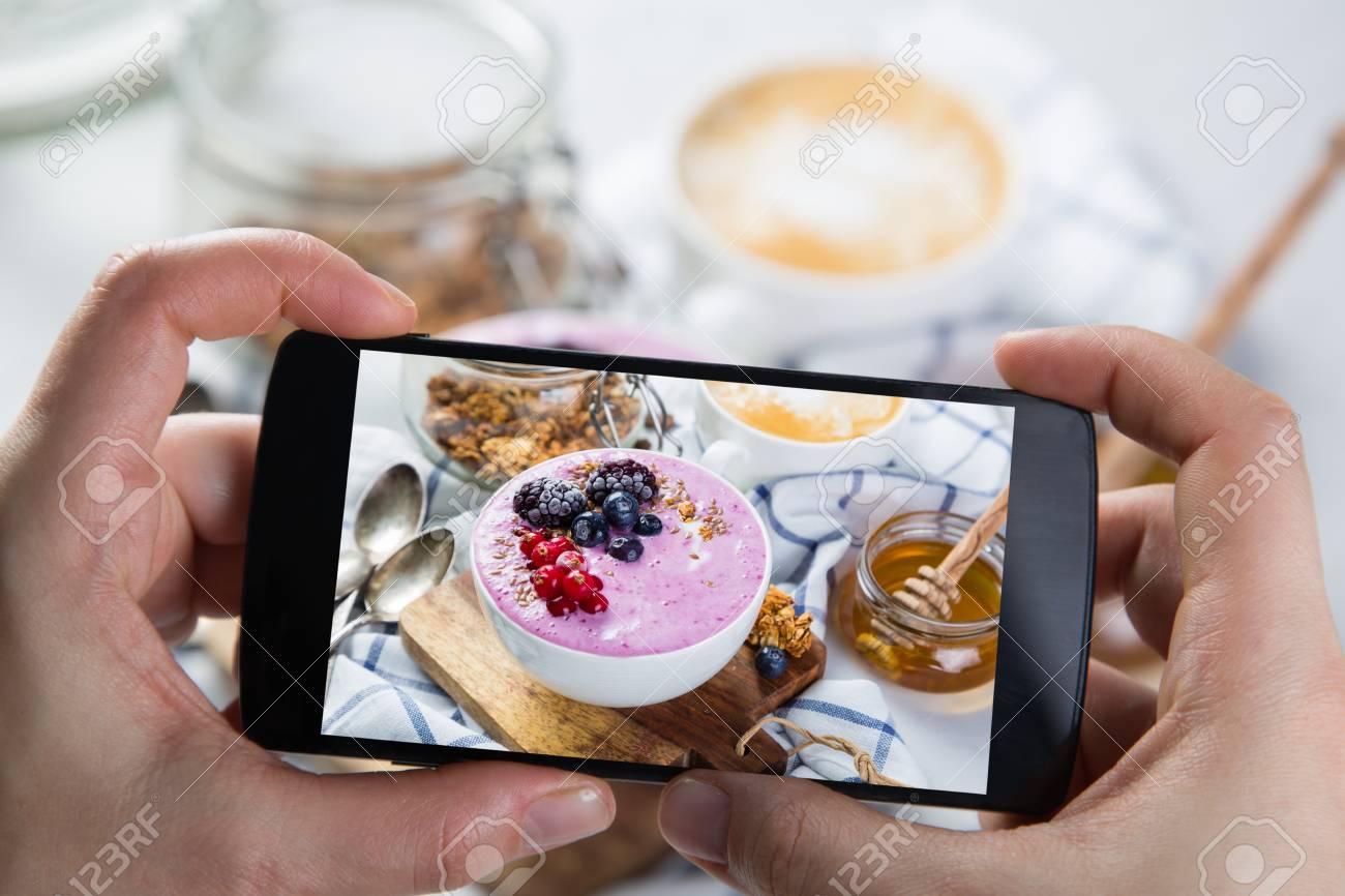 Taking photos of breakfast to phone Stock Photo - 73363047