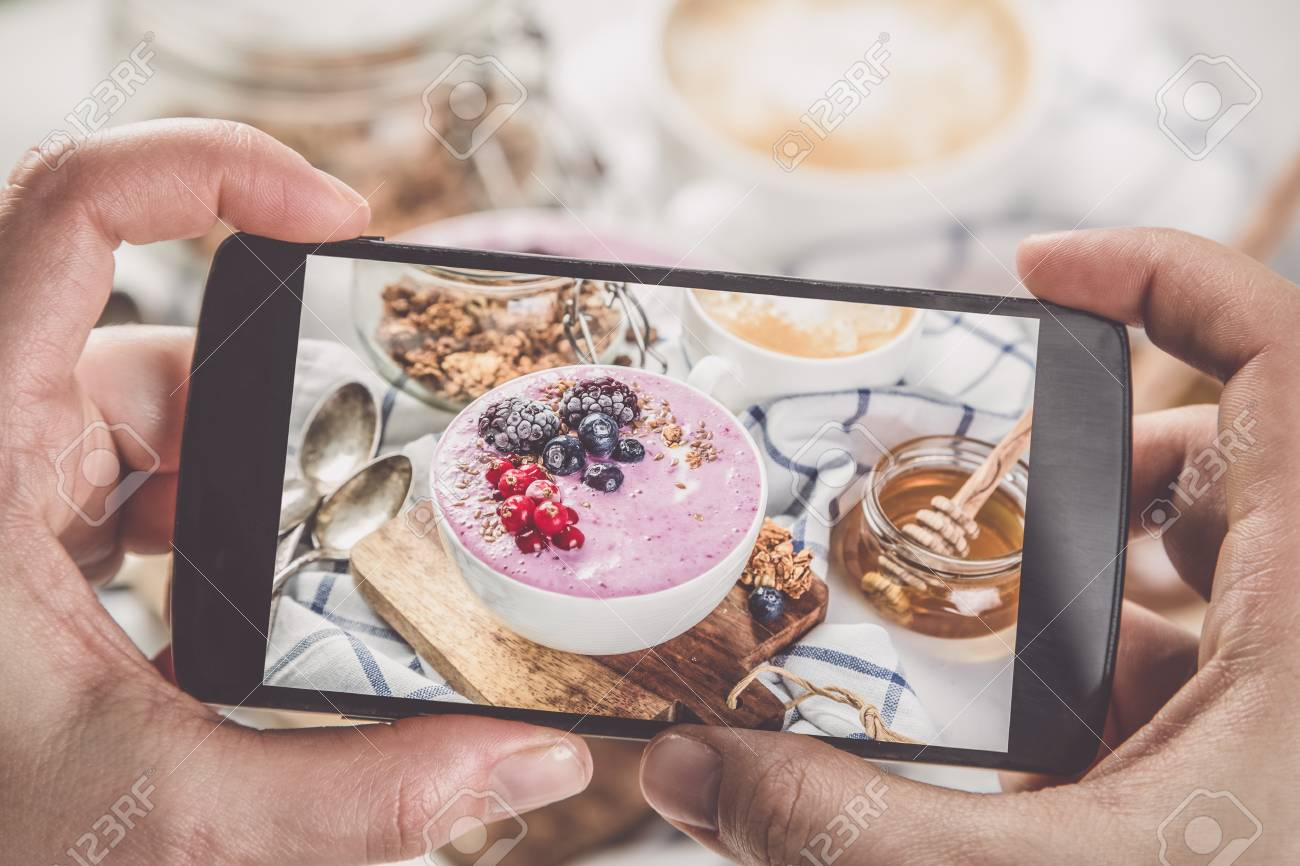 Taking photos of breakfast to phone Stock Photo - 73363048