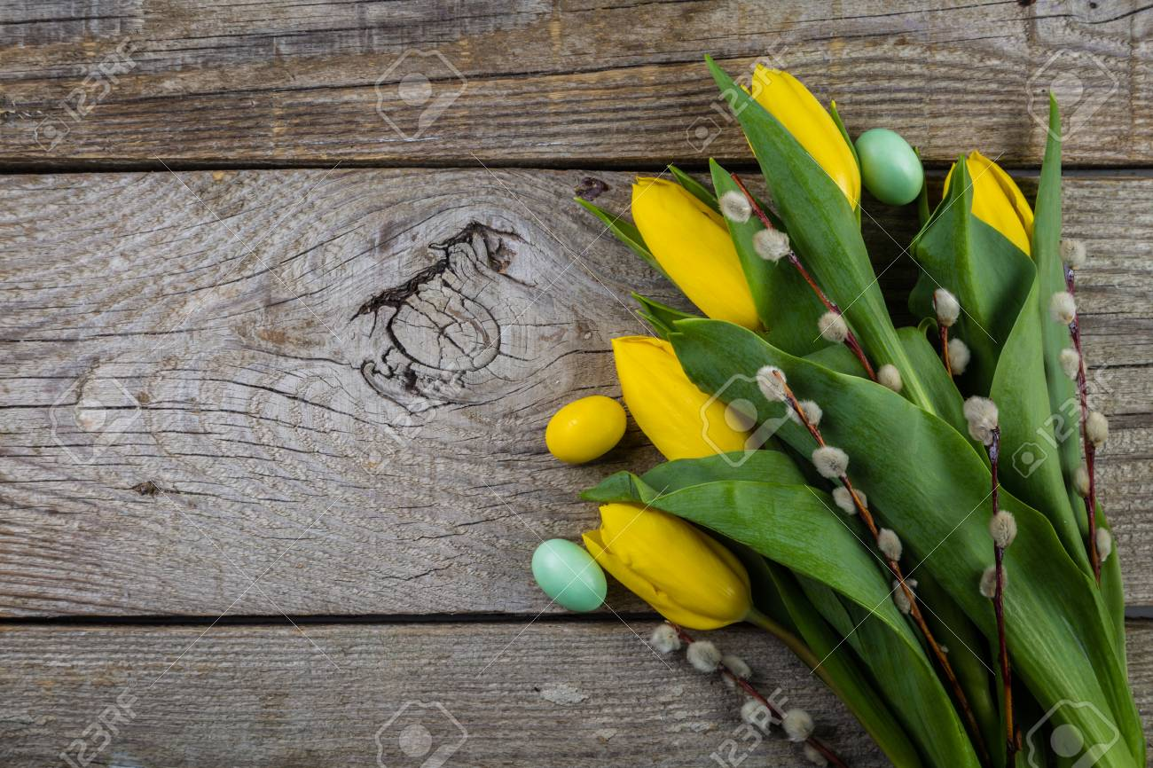 Easter card - decorations on rustic wood background Stock Photo - 73659683