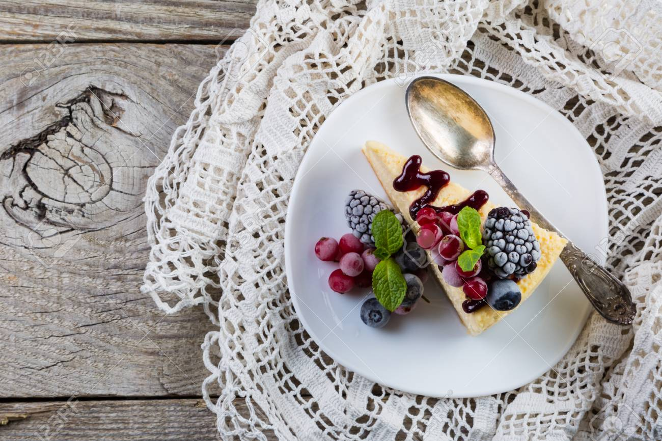 Cheesecake with berries and mint Stock Photo - 73659686