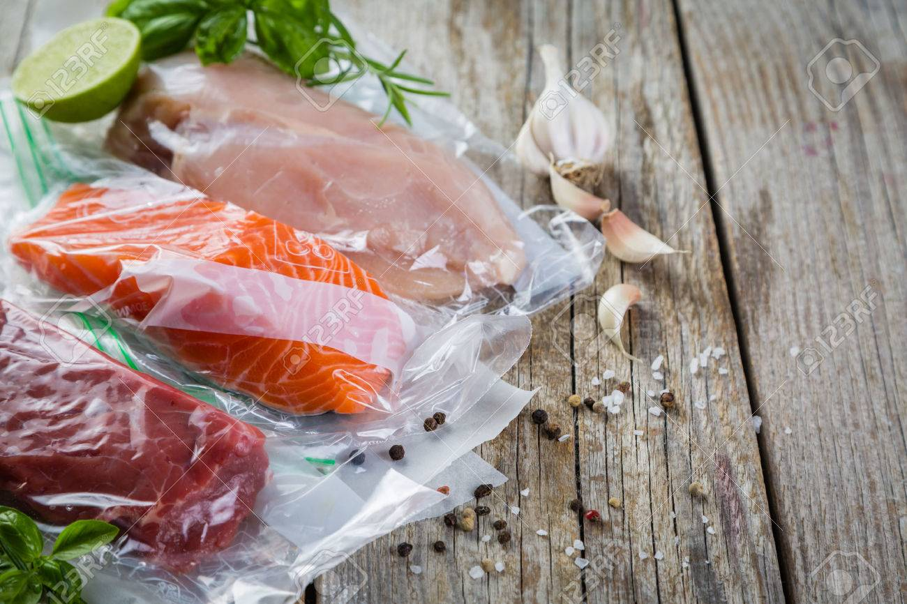 Beef, chicken and salmon in vacuum plastic bag for sous vide cooking Stock Photo - 74051059